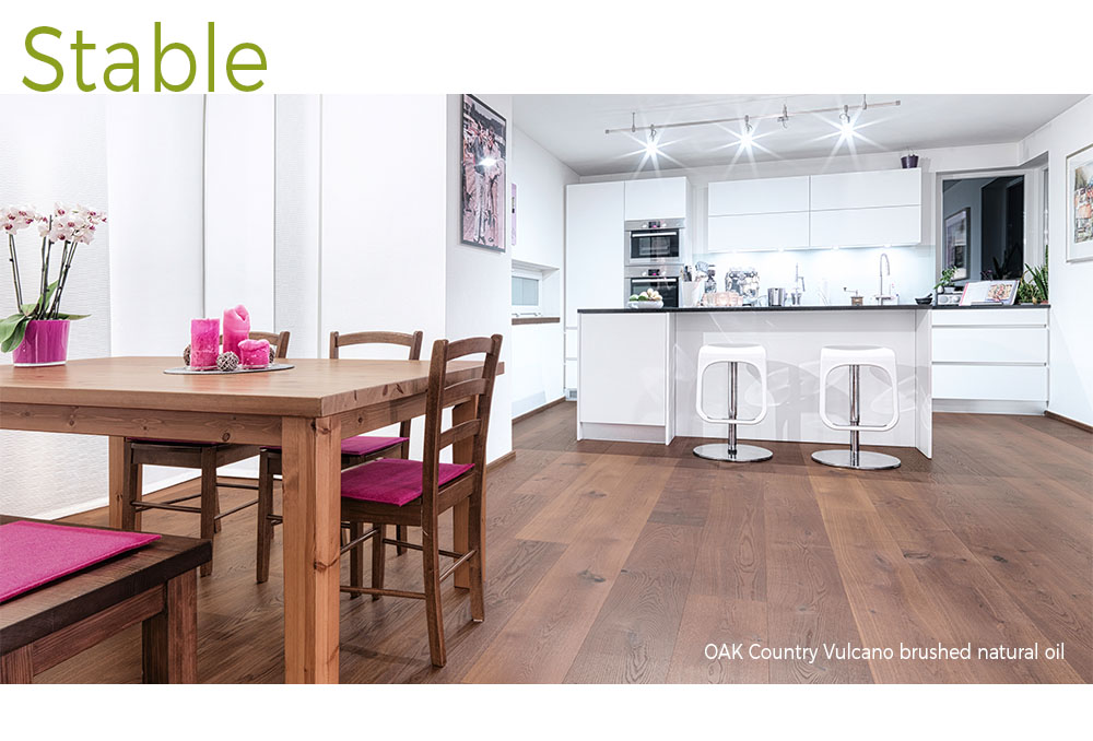 mafi Oak Country Vulcano brushed natural oil wood floors in a white, modern kitchen with a dark wood kitchen table and fuchsia pink accents