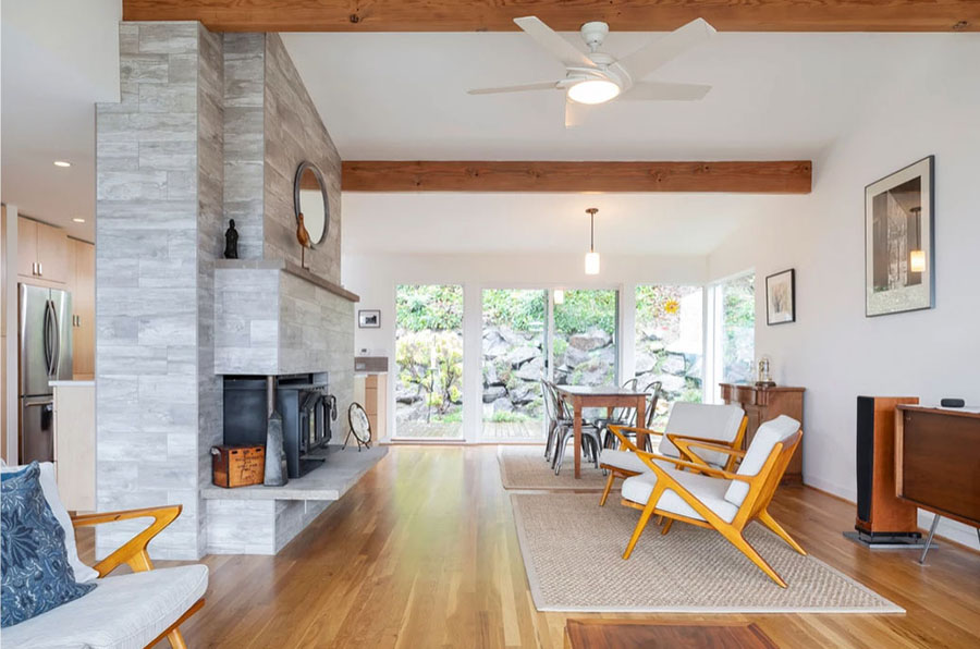 Seattle split-level home remodeled by Pathway Design and Construction features green building materials from Greenhome Solutions, salvaged cabinets and indoor air quality monitoring.  The home will be featured on the 2019 Northwest Green Home Tour.